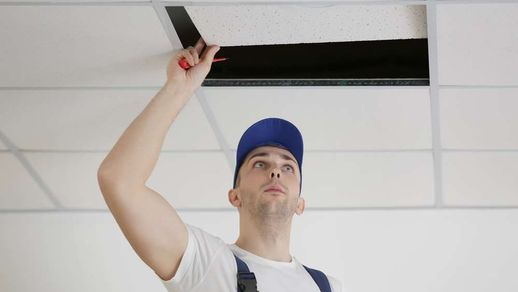 Electrician repairing a ceiling